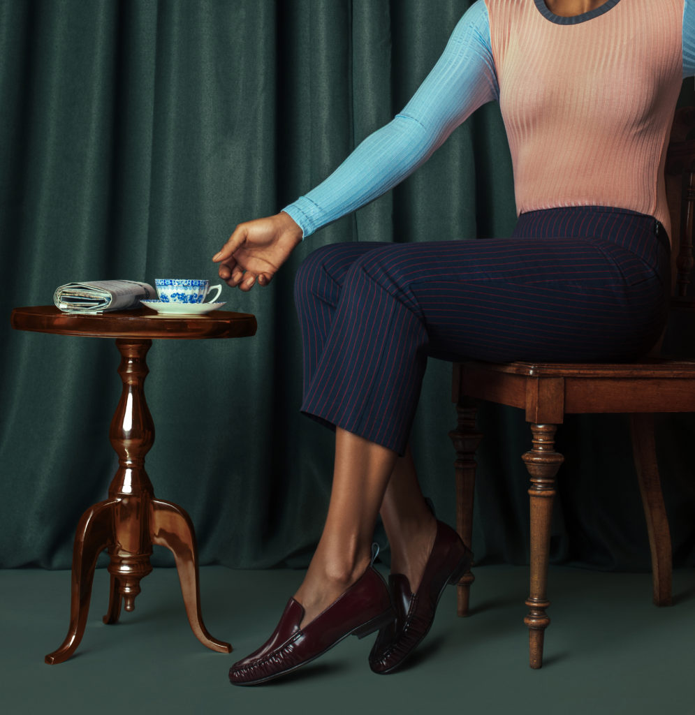 Black woman having a cup of tea for shoe trends spring 2021