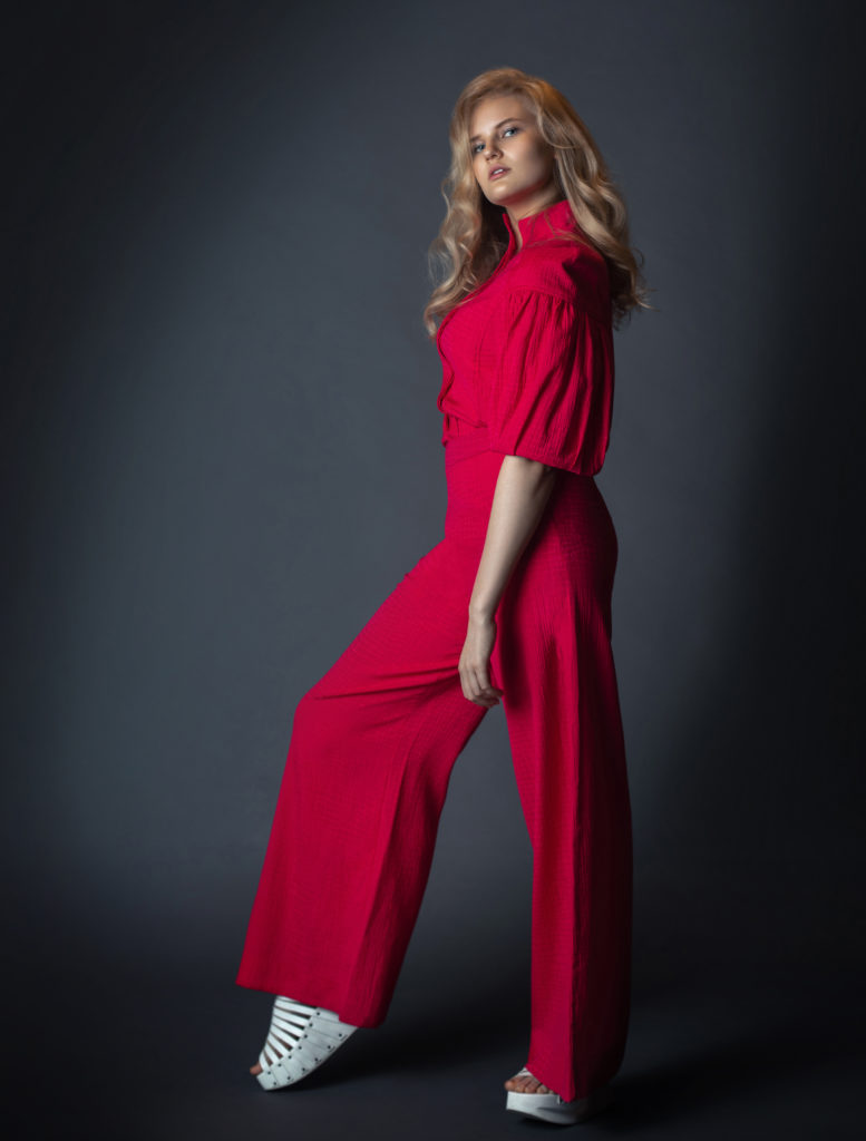 Blonde girl wearing a red Silk Dress by Rabens Saloner for Spring 2021 Fashion Trends