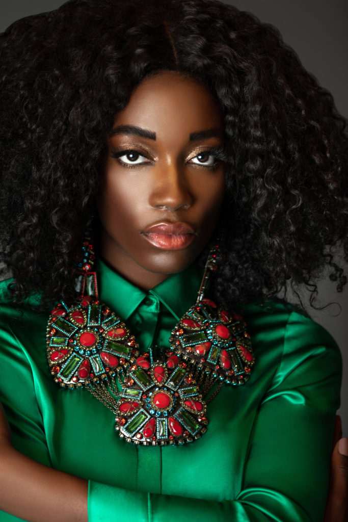 Black girl wearing a green Silk Dress by MADS NORGAARD for Spring 2021 Fashion Trends