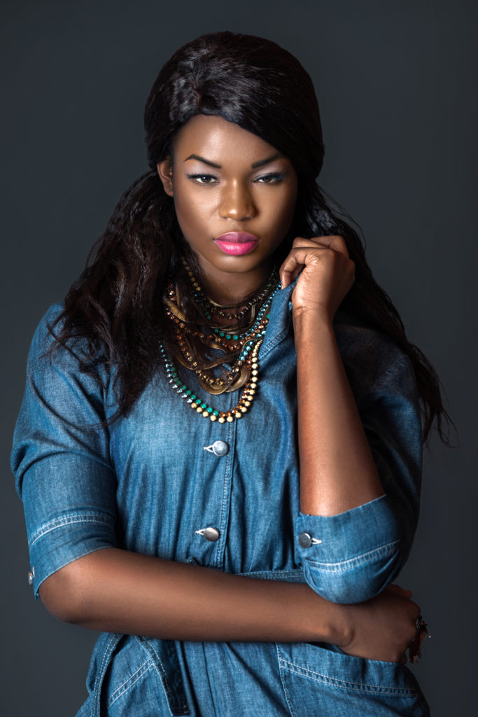 Black girl wearing a blue denim romper for Spring 2021 Fashion Trends