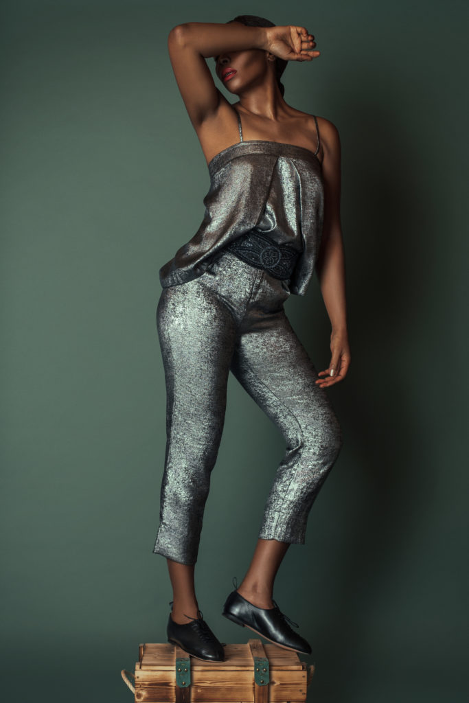 Black girl wearing a silver romper for Spring 2021 Fashion Trends