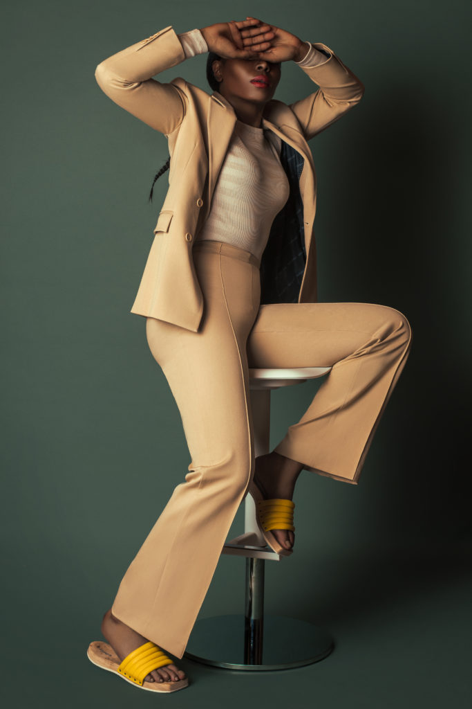 Black girl wearing a beige suit for Spring 2021 Fashion Trends