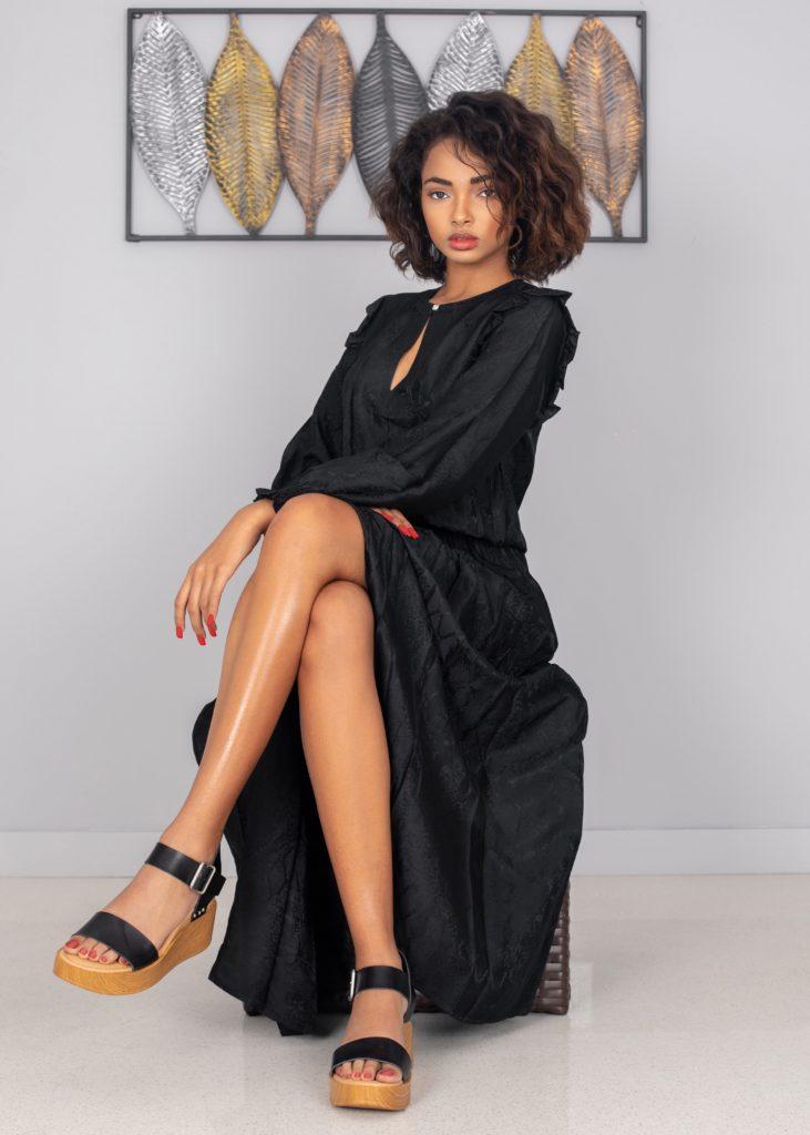 A Gentle Spirit Sitting In Black Dress