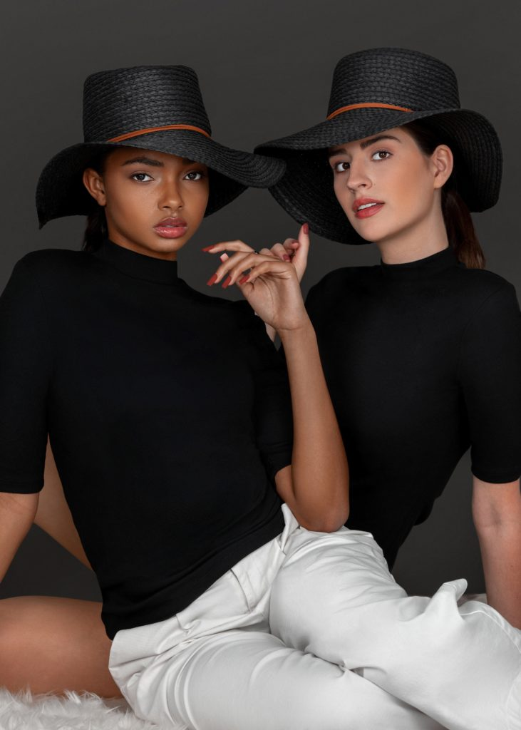 Two Gentle Spirits Sitting Together In Black