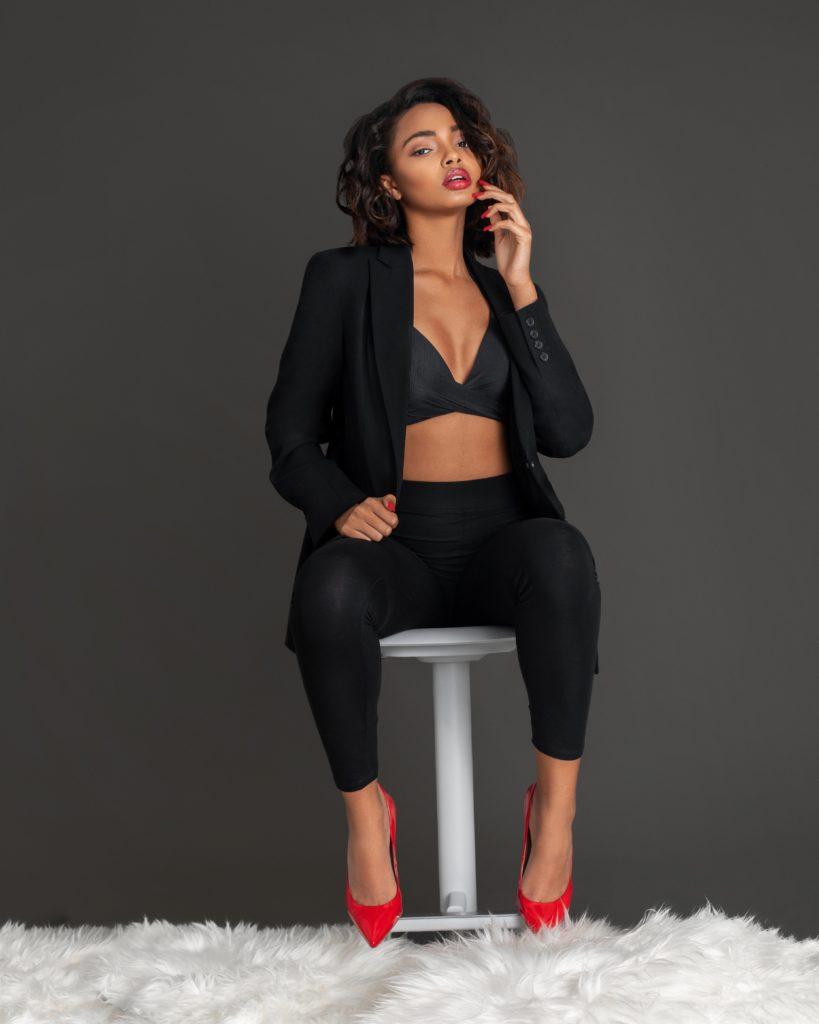 A Gentle Spirit In Red Heels Sitting