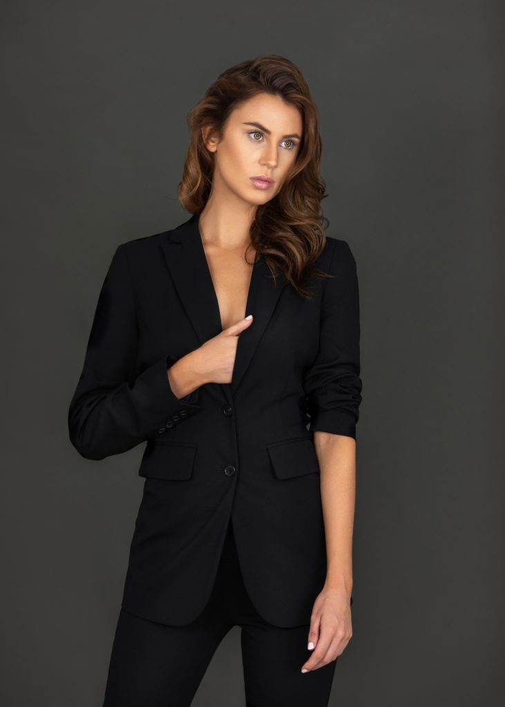 Latin Woman In Black Suit